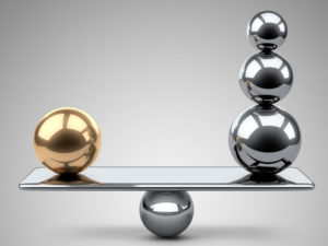 43834615 - balance between large gold and steel spheres. 3d illustration on a grey background.